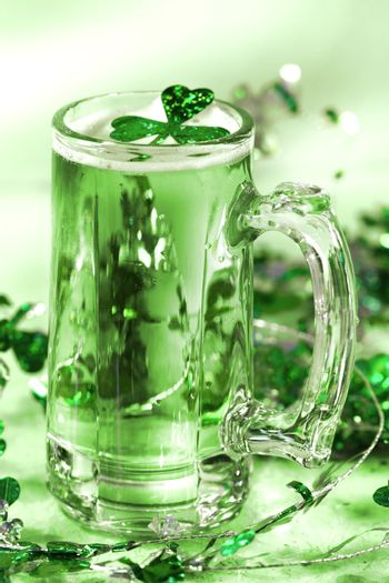 Mug of green beer for St Patick's Day festivities/ Green tone