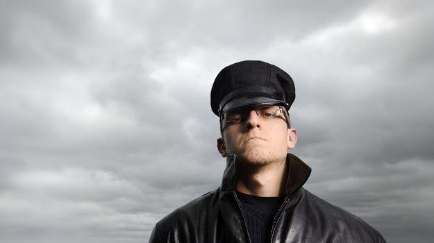 Police man under a stormy sky