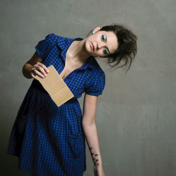 Pretty fashion model with wild hair poses in studio