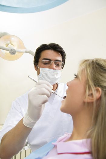 dentist holding an angled mirror