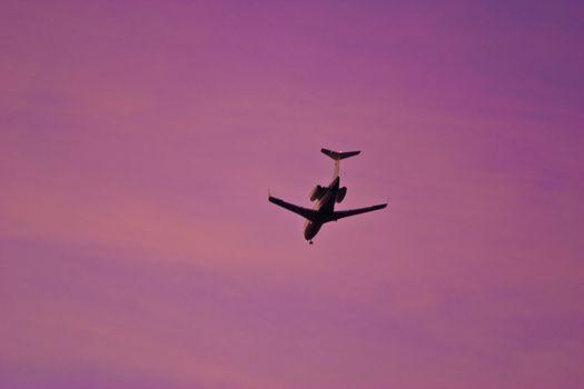 transportation series: jet in the sunset sky