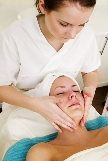 A face massage during a facial at a beauty spa.