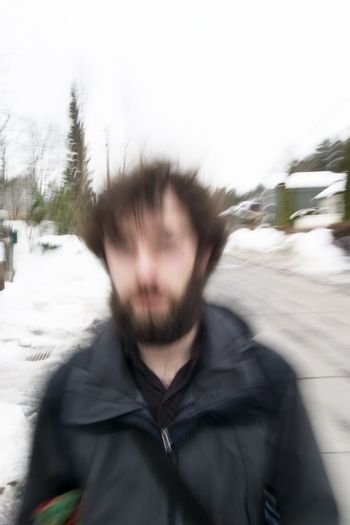 A motion blur abstract of a person walking in a hurry, a late stress rushing concept image.