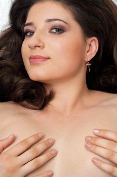 romantic portrait of naked brunette