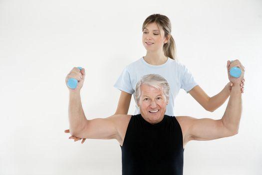 senior man exercising in gym. Copy space