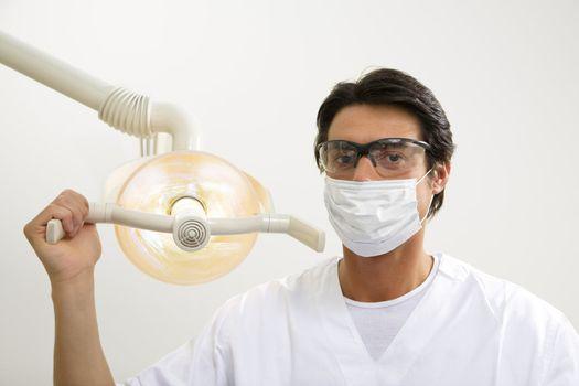 dentist turning on examination light