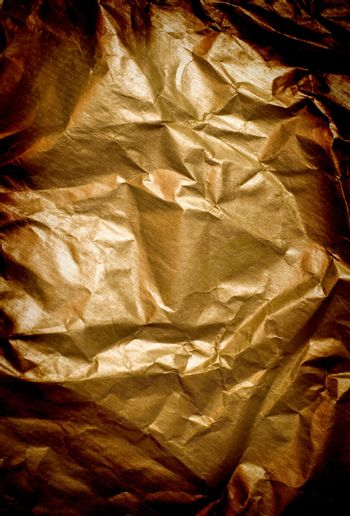 abstract background of wrinkled golden paper