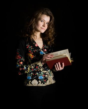 Beauty girl with book on black background