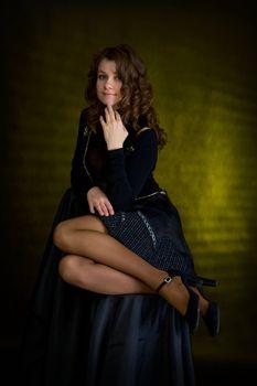 The beauty girl in black on dark background