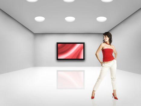 Beautiful woman on big room with a big TV