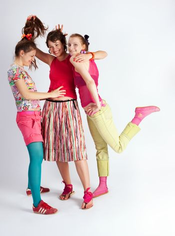 happy young women with a smile in bright multi-coloured clothes