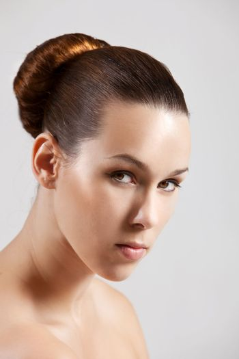 Beautiful brunette with simpel and elegant hairstyle