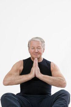 senior man doing yoga indoors. Copy space