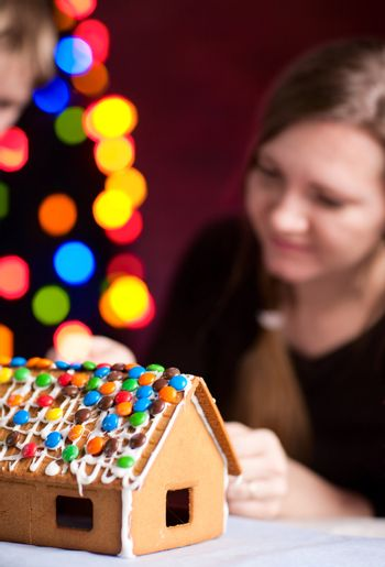 Macro of decorated gingerbread house on Christmas eve