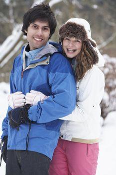 Romantic Teenage Couple In Snow