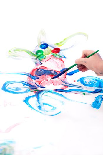 Macro photo of 5 years old boy drawing octopus on white background