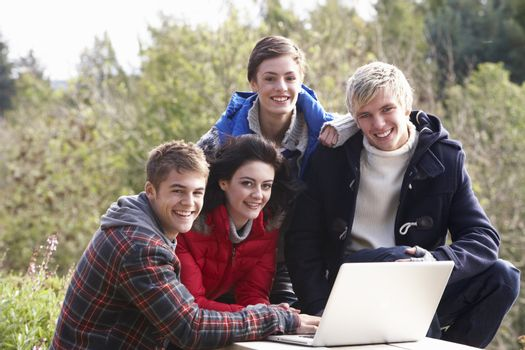 Students with laptop computer