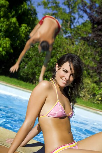 Healthy lifestyle: young woman at the swimming pool