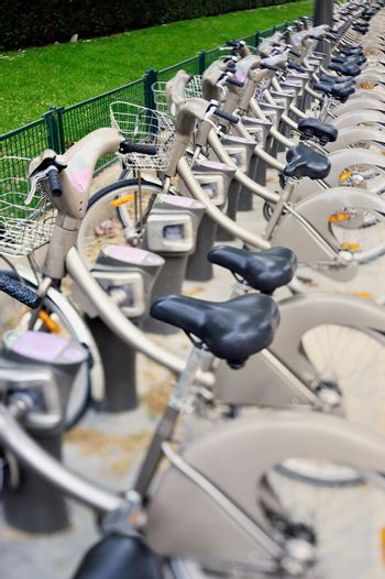 Row of bicycles on the parking.  Photo with tilt-shift lens