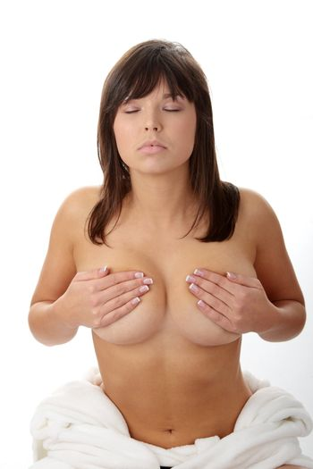 Young beautiful woman topless, in towel