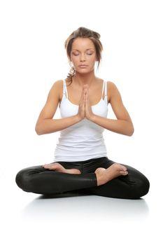 Beautiful young woman doing yoga exercise isolated