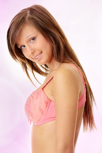 Teen girl in swimsuit over abstract pink