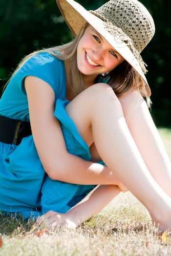 Teenage girl in fresh and happy mood outside in the park