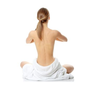 Portrait of young beautiful topless caucasian woman with blue towel on her waist isolated on white background