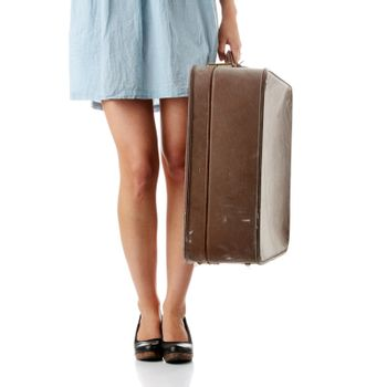 Caucasian woman legs with travel case isolated on white background