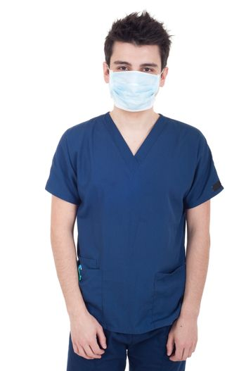 portrait of a young doctor wearing mask isolated on white background