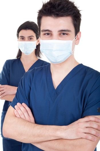 portrait of a team of doctors, man and woman wearing mask and uniform isolated on white background (selective focus)