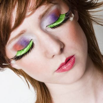 Portrait of a red haired girl with beatifull colourfull make-up