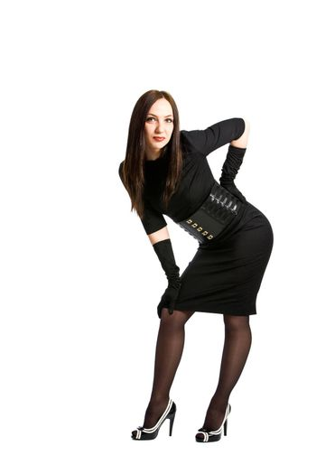 photo of young elegant woman wearing black dress on white background