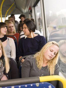 Woman sleeping on the bus