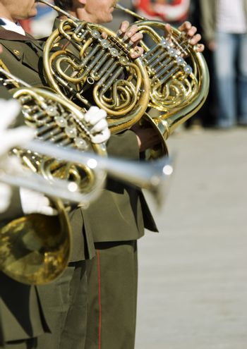 editorial photo,hands of musicians with trumpets (selective focus)