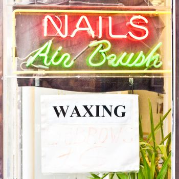 A sign for a backtsreet beaty treatment centre in the UK