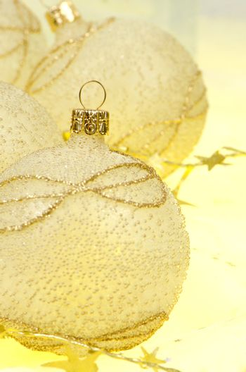 Christmas ball baubles with silver and gold decoration.