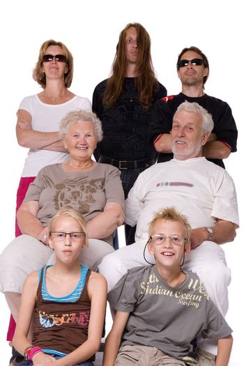 Studio family portrait of a funny family of 3 generations