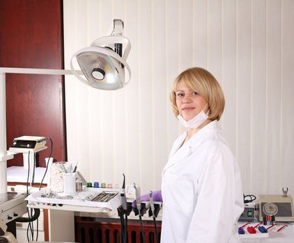 female dentist with equipment in dentist office