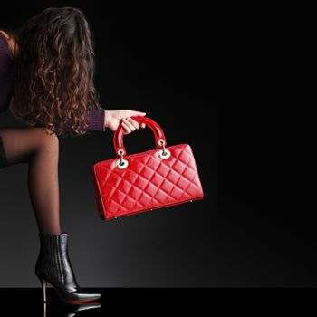 Sexy fashionable woman with red bag