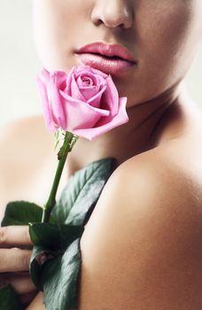 Studio portrait of beautiful lips with rose
