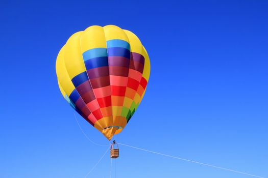 balloon colorful vivid colors in blue sky flying ship