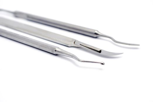 Tools dentist consisting of scalpel, plugger and escalator