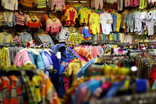 Bright babies clothes department in shop