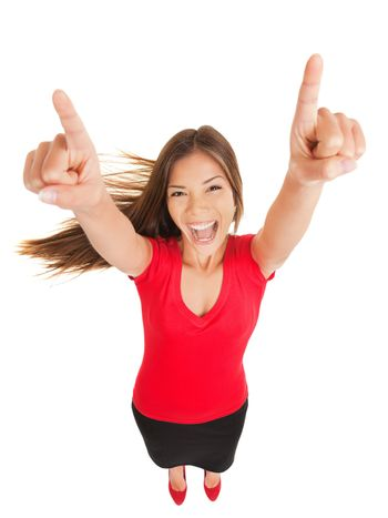Successful woman cheering in jubilation laughing and pointing her hands to the sky, fun high angle full length studio portrait isolated on white background. Multicultural Asian Caucasian business woman.