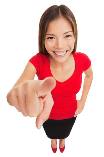 Pointing woman. Attractive smiling woman pointing directly at the camera with her finger as she makes her selection or identifies a person, funny high angle full length portrait isolated on white.