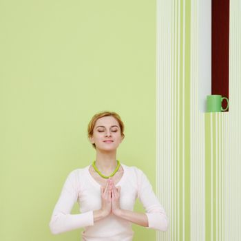 An image of a girl in the pose of lotus