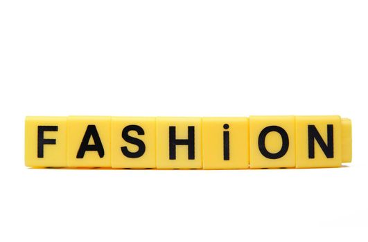 An image of yellow blocks with word ''fashion'' on them