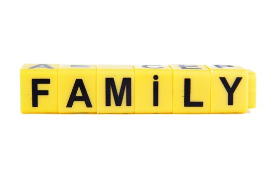 An image of yellow blocks with word ''family'' on them