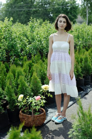 An image of a young girl in the garden